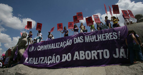 Pro choice feminists demonstration in Sao Paolo. Sign reads: 'No to the criminalisation of women! Legalise abortion!'