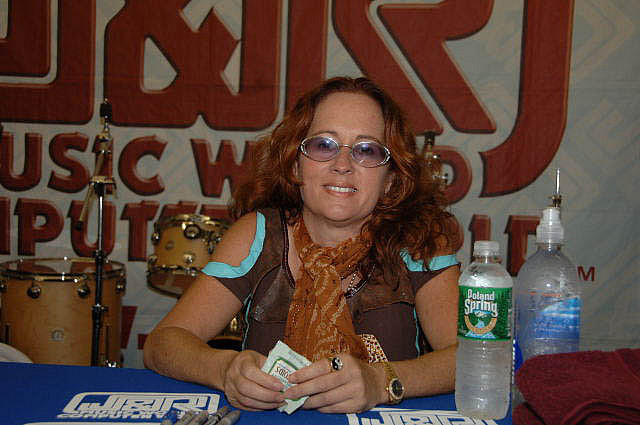 Teena Marie with red hair and tinted glasses, signing Autographs at J&R Musicfest 2006