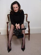 Photo of Anna Span with a camera