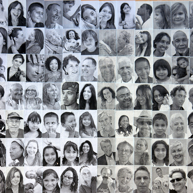 A black and white photograph made up of lots of small square photographs of the faces of a diverse range of people.