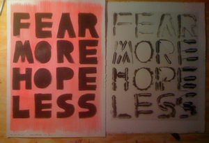 a photograph of handmade print next to one of the stencils. They read