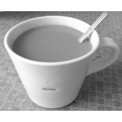 This image is called First Coffee. It is a black-and-white photograph taken by Helen. If using elsewhere, please ensure correct attribution.