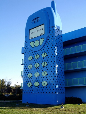 giant blue structure resembling a mobile phone on the side of a building, enclosing the building's staircase