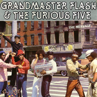 Cover of The Message (album) showing members on a crossing with a ghettoblaster and wearing outfits typical of the mid 1980s.