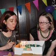 me and Catherine blow out candles on F-Word cake