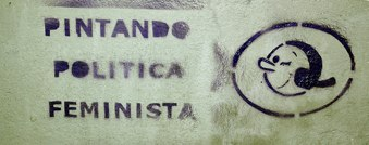 Graffiti in Madrid of Olive from Popeye and the words 'Pintando Politica Feminista', or Painting Feminist Politic