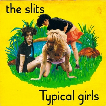 Typical Girls EP cover. Bright yellow with photo of the group (marked with facepaint and possibly looking muddy) overlaid onto a drawn grass island in front of a pond in the middle. Ari Up (sitting, left), Viv Albertine (on hands and knees, middle, front) and Tessa Pollitt (standing and bending to the side, right, back)