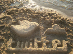 A photograph of a sand sculpture of the word twitter and the twitter logo. It really is much more impressive than the words I am using make it sound.