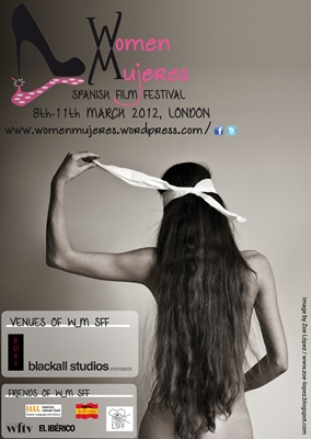 Promotional poster for the festival, featuring a topless white woman facing away from the camera, long hair down her back, pulling a white blindfold from her eyes.